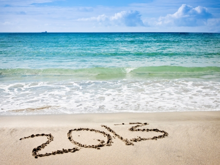 new year 2013 digits on ocean beach sand photo