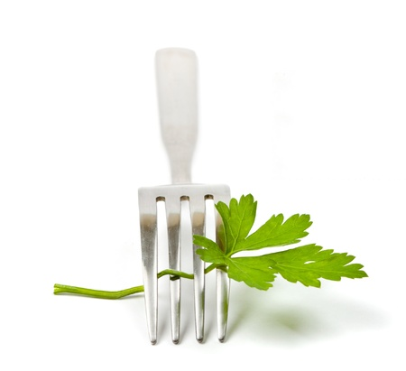 Parsley and fork isolated on a white background (with sample text) photo