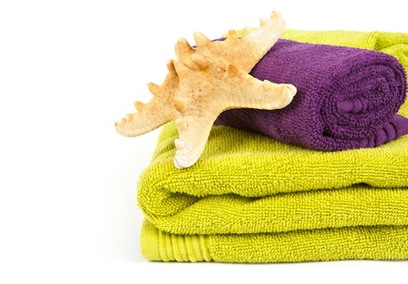 colorful towels with Starfish on white background photo