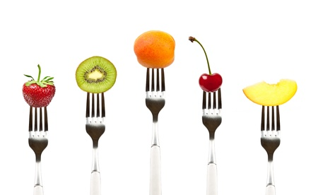 composition: fruits on the collection of forks, diet and healthy eating concept