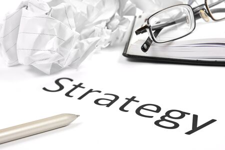 investment strategy: business or investment strategy concept with pen paper, notebook and glasses