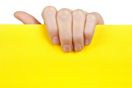 holding a sign: Hand holding yellow empty paper  Stock Photo