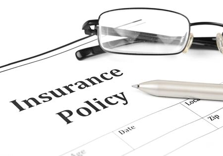 home insurance: insurance policy form on desk in office showing risk concept  Life; Health, car, travel, for background