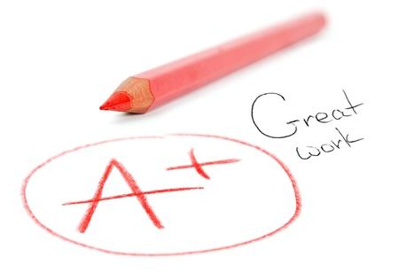 Mark A + mit rotem Stift auf weißem isoliert. Great work Standard-Bild - 17925911
