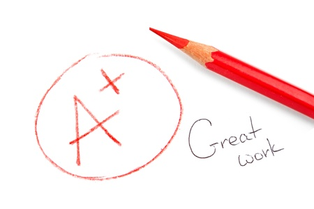 grades: mark A+ with red pencil isolated on white. Great work