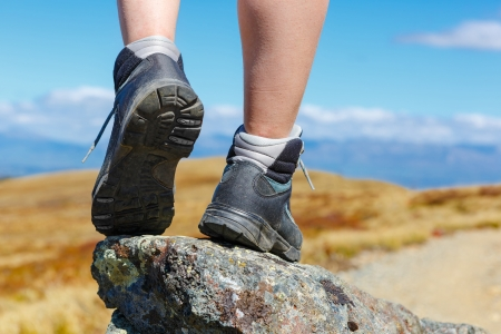 safety boots: hiking boots on the rock in the mountains