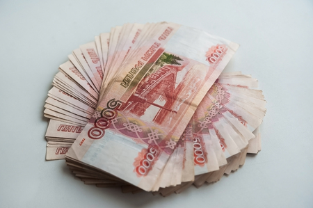 Russian rubles and American dollars. Money on a white background. Money on the texture of a tree. Money, crisis, salary, sale, purchase