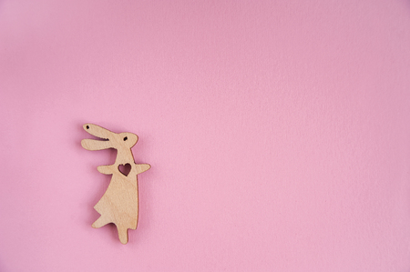 Wooden bunnies on a pink background Stock Photo