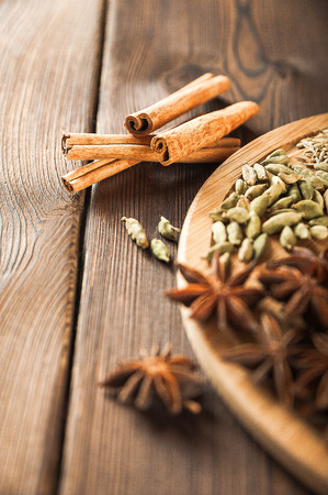 Textured background and copy space. Cinnamon, star anise, fennel, peppercorns, cloves, tea masala seasoning as a texture Stok Fotoğraf