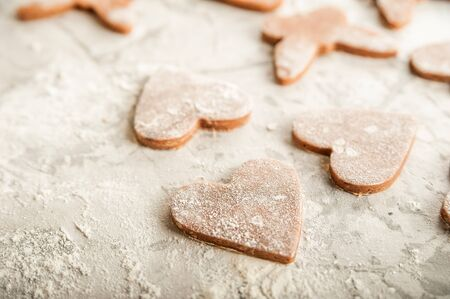 The texture of the dough closeup. Heart shaped gingerbread baking. Homemade cookies for Valentines Day and copy space. Keto baking.The texture of the dough closeup. Heart shaped gingerbread baking. Homemade cookies for Valentines Day and copy space. Keto baking.