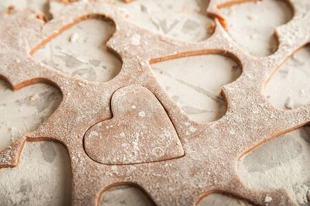 The texture of the dough closeup. Heart shaped gingerbread baking. Homemade cookies for Valentines Day and copy space. Keto baking. Stok Fotoğraf