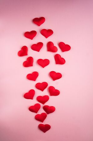 Flat lay of the picture by February 14th. Miniature hearts for Valentine's Day.