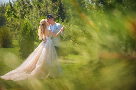 Wedding couple in the summer on a walk in the Dnieper, Ukraine. Eco wedding in nature. Bride and groom close-up and copy space.