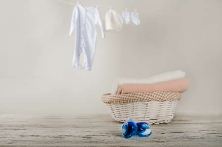 Laundry capsules close-up and copy space. Laundry, clothes drying on a rope, laundry basket, washing powder, washing gel.
