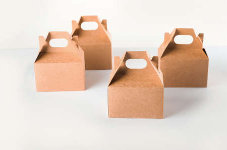 Cardboard boxes on a white background. Ecological packaging of paper products close-up and copy space. Craft containers, packaging, boxes, packages.