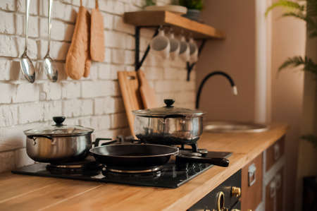 Rustic kitchen details. Empty pans and pans in the kitchen close-up and copy space.