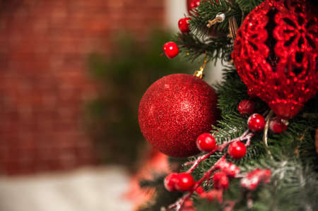 Christmas tree decor in red style and bokeh. Christmas tree, Christmas decorations, toys close-up and copy space. Hygge New Years concept. 스톡 콘텐츠