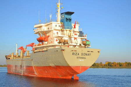 dniper: KHERSON, UKRAINE-OCT 10, 2014: CargoContainership RIZA SONAY over river Dniper in port Kherson, Ukraine Editorial