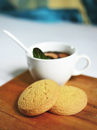 A cup of hot tea with oat cakes.