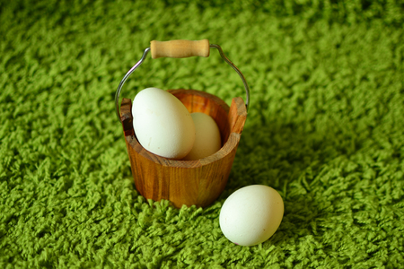 White eggs on the green grass.