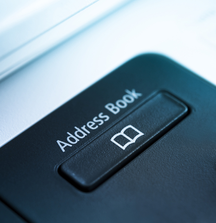 copy machine: Black address book button on a machine