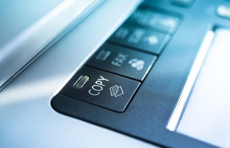 copy machine: Copy button on a copy machine with blue lights