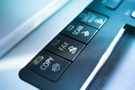 Copy and fax button on a copy machine with blue lights