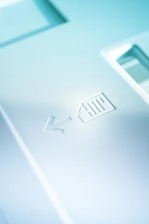 office machine: Insert paper here marking on an office machine Stock Photo