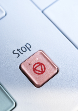 copy machine: Red Stop button on a copy machine