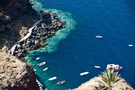 Deep blue Aegean Sea with clear water and colourful boat Stock Photo