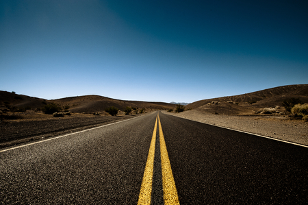 Long road to the nomad, clear sky Stock Photo