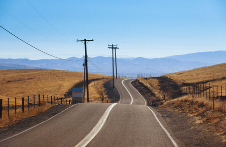 livermore: Road across country side meadow farm Stock Photo