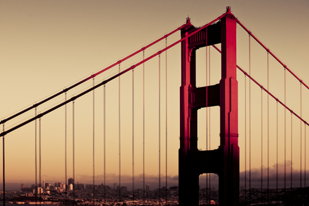 The famous red Golden Gate Bridge closeup in Sunset time