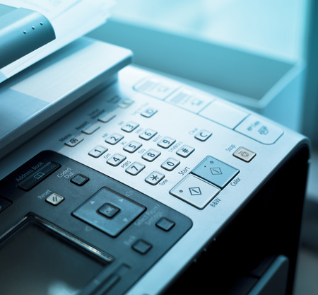 dial pad: Dial Pad on a fax machine with blue lights