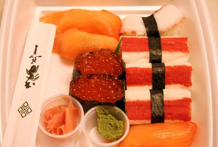 takeout: Several kinds of Sushi in take-out container.