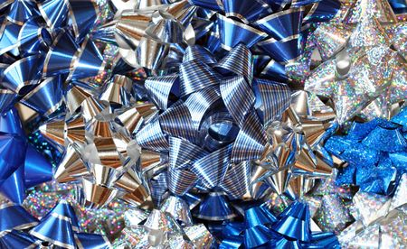 foil: Assorted blue & silver, sparkly foil bows for Christmas. Stock Photo