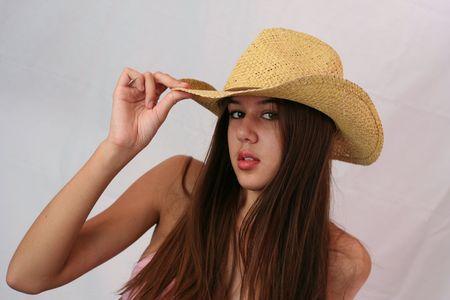bath: Pretty woman dressed in pink bikini and cowboy hat.