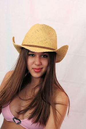 stampede: Pretty woman dressed in pink bikini and cowboy hat, ready for the Stampede.