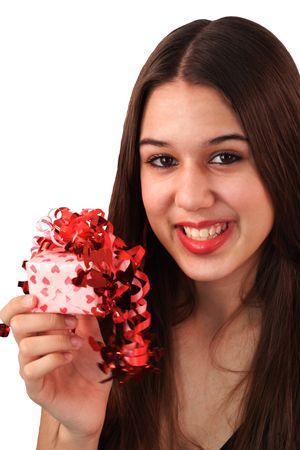 Be My Valentine.  A pretty young woman offers a beautifully wrapped gift to her Valentine. photo