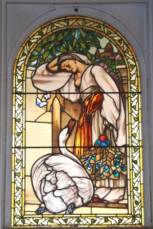 Beautiful goose & maiden stained glass window.  Craigdarroch Castle, Victoria, British Columbia, Canada.