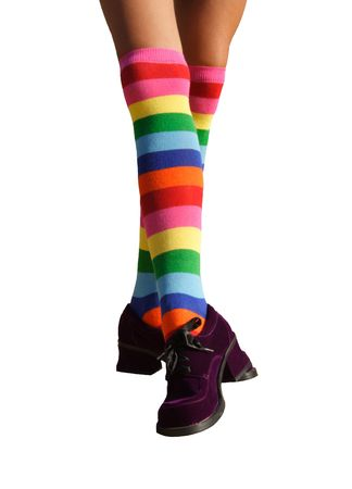 suede: Isolated dancing legs in striped knee-hi socks and wonky purple suede shoes.