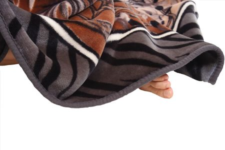 poking: Girls toes poking out from under a warm, soft, cozy blanket.  Isolated. Stock Photo