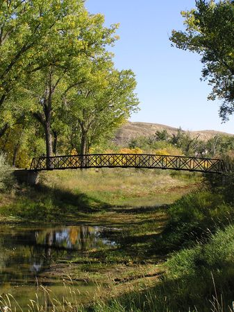 A bridge spans a now nearly dry creek bed.