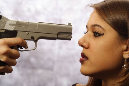 women with guns: An illustration of teen violence and violence against women. Stock Photo