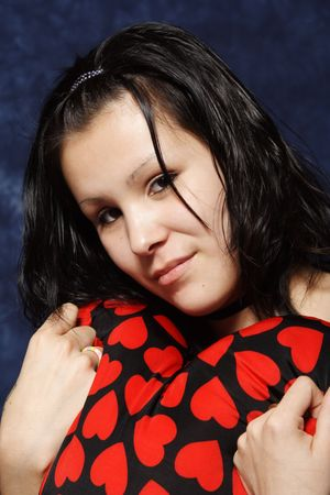 native american girl: A beautiful native girl hugs her Valentines gift close to her heart.