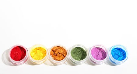 A rainbow of brilliantly hued powder eyeshadows.   photo