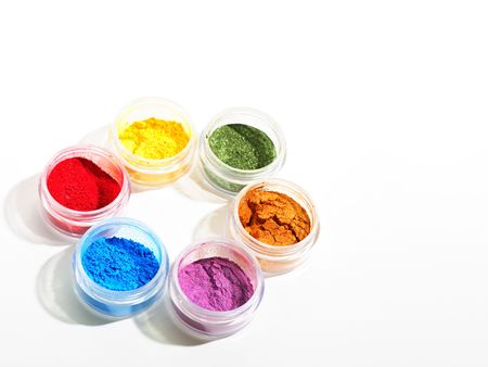 A colorful group of brilliantly hued powder eyeshadows.   photo