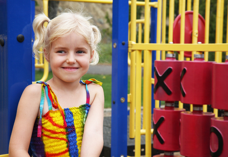 Portrait of a five year-old little girl at the playground. Stock Photo - 1620956