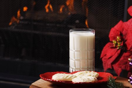 Christmas Eve scene.  Shortbread cookies and milk set out by the fireplace, in preparation for Santas arrival. Stock Photo