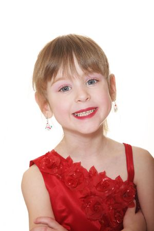 Confident 5 year old little girl in red  dress & earrings.